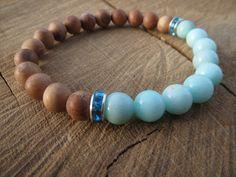 Check out this item in my Etsy shop https://www.etsy.com/listing/225554790/sandalwood-aquamarine-bracelet-beautiful