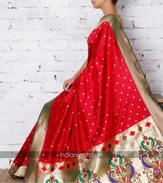 Handwoven red Paithani silk saree with zari work by Surekha Arts on…