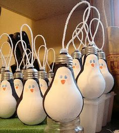 so cute.  made from lightbulbs....