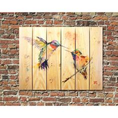 Give your space a burst of garden charm with this 'Love Bird' indoor/outdoor wall art depicting two hummingbirds in mid flight. Designed to inject color and fun indoors or outdoors, this cedar wall ha