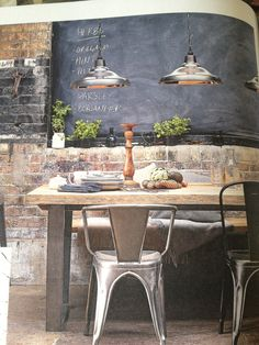 Exposed brick, massive blackboard wall, thick wooden table, factory lights, industrial chairs. My perfect kitchen. #johnlewiswinter