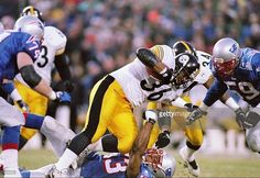 Running back Jerome Bettis #36 of the Pittsburgh Steelers runs over linebacker Chris Slade #53 of the New England Patriots during the Steelers 24-21 win at Foxboro Stadium in Foxboro, Massachusetts. Mandatory Credit: Brian Bahr /Allsport