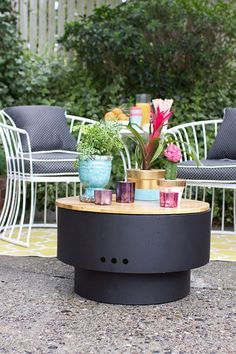 We love the HotSpot Solid Base Revolver Fire Pit. It doubles as an outdoor coffee table when you're not roasting marshmallows. That makes it a great fire pit for a small patio. Aileen Allen of At Home In Love styled this cozy outdoor space. See the complete patio makeover on The Home Depot Blog. || @aileenallen
