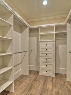 Closet Organization. Built-in Closet. White Custom Closet. Light Rustic Hardwood Flooring.