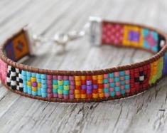 "Items similar to The ORIGINAL bright and colorful tribalesque native style ""tiny squares"" design leather wrap loomed friendship bracelet on Etsy Bead Loom Bracelets, Bracelet Crafts, Wrap Bracelets, Friendship Bracelet Patterns, Friendship Bracelets, Leather Jewelry, Beaded Jewelry, Bracelet Cuir, Bead Loom Patterns"