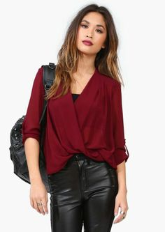 I love this cranberry shirt with black leather pants, purse to match