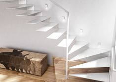 Indirect stairs clamped to the wall
