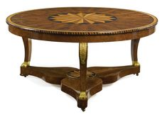 A Charles X ormolu-mounted and satinwood-inlaid mahogany center table circa 1825