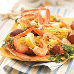 Low Country Boil ---  We called this Frogmore Stew.  boiled outside in turkey fryer and dump right onto newspaper.  Eat with your fingers!  Fun food when you have family & friends over :)