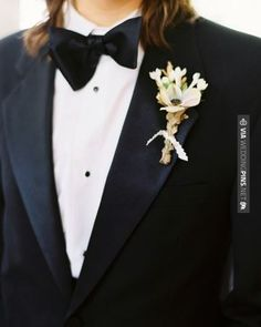 Amazing - Dashing against a black suit: single anemone backed by a cluster of bavardia, bound with dusty miller sprayed gold. | CHECK OUT MORE GREAT BLACK AND WHITE WEDDING IDEAS AT WEDDINGPINS.NET | #weddings #wedding #blackandwhitewedding #blackandwhiteweddingphotos #events #forweddings #iloveweddings #blackandwhite #romance #vintage #blackwedding #planners #whitewedding #ceremonyphotos #weddingphotos #weddingpictures