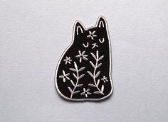 Floral Cat Iron on patch - sew on patch - cat embroidered patch  A new embroidered version of my black floral cat patch!  The patch measures 2 inches wide and 3 inches high. The patch can be ironed or sewn onto place on your favourite jacket, jeans, jumper, hat or anywhere else you can think of - full instructions are supplied on the back of the packaging.  All of my items are carefully packaged and sent via first class post. Please read my shipping policies carefully before purchase. More…