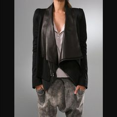 Elizabeth and James Yoshimoto jacket Elizabeth and James Yoshimoto jacket. Black with leather vest inside. Vest can zip out and be worn alone, as can coat. Structured jacket. Super hot! Size 8. Coat popular with many celebs. Statement piece for sure! Elizabeth and James Jackets & Coats Blazers