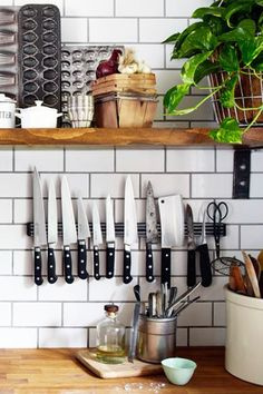 Hang Knives Together If you have a small kitchen, a knife block is pointless since it takes up valuable chopping space. Use a magnetic strip on your backsplash to hold your sharp utensils instead. See more at Design Sponge Kitchen Shelves, Kitchen Backsplash, Kitchen Storage, Kitchen Utensils, Kitchen Knives, Kitchen Sink, Pantry Storage, Easy Backsplash, Ladder Storage