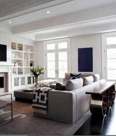 Great layout. Wall unit. Couch. Rug. Sofa table.