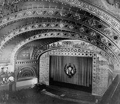 """The interior of the Auditorium Building in Chicago built in 1887. The rectangular frame around the stage is the proscenium """"arch""""."""