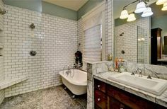 bathroom remodel - enclose tub in shower by expanding glass - don't like the marble, switch that out - and add rainfall showerhead above - not sure I'm crazy about the subway tile either... hmph.