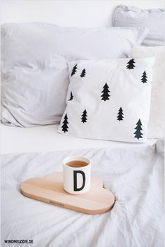 scandinavian interior bedroom black and white tree pillow