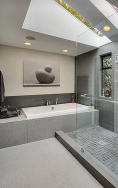 Tub at the end of shower idea  This modern bathroom is very spacious and has an open feel.