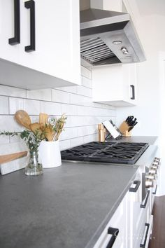 Modern Kitchen Interior Remodeling Lovely Modern Farmhouse Kitchen from Interiors By Sarah Langtry with concrete look quartz counters, white cabinets and matte black hardware - Farmhouse Kitchen Interior, Farmhouse Kitchen Cabinets, Modern Farmhouse Kitchens, Home Decor Kitchen, Kitchen Ideas, Kitchen Modern, Kitchen Black, Kitchen Inspiration, Modern Room