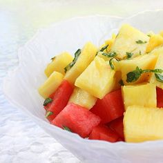 Pineapple & Watermelon Salad:  1 pineapple, cut into bite-sized pieces  1/4 cup fresh basil, thinly sliced  1 lime, juiced  1/2 watermelon, cut into bite-sized pieces  Mix pineapple pieces with basil and lime juice. Place watermelon pieces in serving dish and pour pineapple over the top. So not stir together. Garnish with lime and basil.