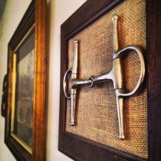 A bit in a frame over burlap. This would be a great way to displace bits that are in the barn instead of a wall hanger. Just put them on little hooks so they can be removed. www.thewarmbloodhorse.com