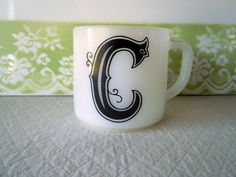 Vintage Letter C Monogrammed Coffee Mug White Milk Glass. $9.00, via Etsy.