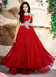 Lustrous red net and satin wedding gown designed with embroidery, resham, zari, bead, lace and patch border work. Available with matching santoon bottom. (Slight variation in color is possible.)...