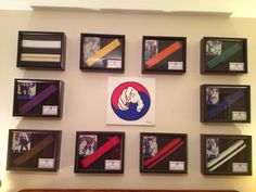 One of our students moms took a photo of her son at each belt promotion and used shadowboxes from Michael's Arts & Crafts to display the belt, photo, and promotion certificate (business card size) for each one. In the middle she put a hand painted versio Taekwondo Belt Display, Martial Arts Belt Display, Taekwondo Belts, Martial Arts Belts, Karate Belts, Ata Taekwondo, Judo, Krav Maga, Mma