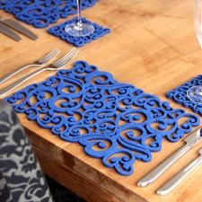 laser-cut felt placemats - two pack - blue swirls by alljoy - This pack of two rectangular placemats in royal blue is laser-cut from felt by the small Dublin-based maker, Alljoy Design (so named because they love to spread joy with their fab products!). The ligh