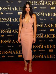 Blushing! Jessica Gomes stole the spotlight in a tight pink dress at the Sydney premiere of Liam Hemsworth's new movie The Dressmaker on Sunday night