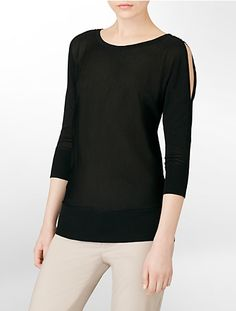 Boat neck, 3/4 dolman sleeve with cold shoulder, and trim at shoulder seam. Rib cuff and hem.
