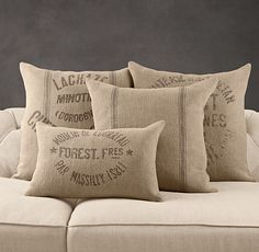 Vintage French Grain-Sack Linen Pillow Covers  $49 - $59  [Restoration Hardware]    For generations, these logos adorned cloth sacks used to carry French grains and flours. Today, they make a vintage impression on our herringbone-woven linen pillow covers.