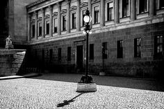 Disturb by Michaela Sibi - PIllows and Neo-Classicism in front of the Austrian Pariliament, Vienna, in the middle a light in the style of the 19th century.   I disturbed it with black, breaking in from the left and right side.
