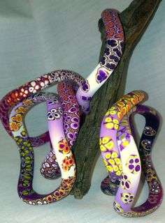 "purple ""wiggle"" bangles by Myriadbeads"