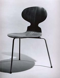 SIDE CHAIR Arne Jacobsen (Danish, 1902–1971) ca. 1951 Plywood, steel, rubber mounts, metal glides, vinyl H. 30, W. 16-1/4, D. 21 inches The chair was designed to be light, stable, easy to stack up, and to minimise tangling the user's feet. The original model had three plastic legs and a seat made from form-moulded laminated veneer. The chair has since proved very popular although the plastic in the legs was replaced by tubular steel, and a version with four legs was also made.