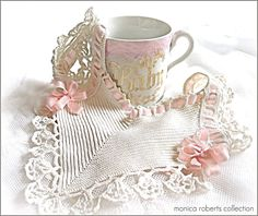 antique hand-crocheted French bib (bavoir) and china 'baby' cup