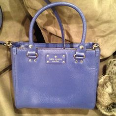 """Kate Spade Blue Bag Kate Spade cowhide leather in Emperorble Blue 14-karat light gold plated hardware  KSNY signature embossed Logo Durable rolled leather handles Detachable, 5 prongs adjustable leather shoulder crossbody strap Open top, center zip compartment  Interior  Kate Spade custom woven fabric lining Zip & 2 multifunction pockets  10"""" ( L ) x 8"""" ( H ) x 4"""" ( D ) Handles - 5"""" drop Shoulder Crossbody Strap - Removable & 5 prongs adjustable kate spade Bags Shoulder Bags"""