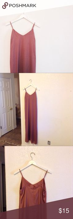 Forever 21 Satin Maxi Dress NWT, never worn. This maxi dress has a loose fit with a deep neckline, adjustable straps, and a zip up back. I bought two of these to use as bridesmaids dresses for my boho wedding, but the color was darker than the pic online. I have 2 dresses, both size Medium. Personally, I think forever 21 runs small so I would recommend these dresses to a smaller medium, or a l small (sizes 2-8 best). Questions and offers are welcome Forever 21 Dresses Maxi