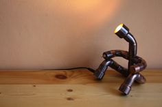 Cute light man. The lamp was made by antiqued copper fittings. It operates from 12 V and 2 W LED bulb is into head. The brightness is low, therefore I recommend for mood lamp. You can light the lamp exc wall, picture, or little statue. The head is rotating. The switch is in hand, the jack is in leg. Does not heat up, and not consume much. Mood Lamps, Can Lights, Unique Lamps, Secret Life, Antique Copper, Bulb, Statue, Led, Canning