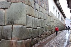 Cusco-A-boy-walks-down-the-foot-street-Hatunrumiyoc-in-Cusco.-The-wall-on-the-left-is-rumored-to-have-been-part-of-the-palace-of-Inca-Roca.