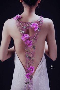 Flowers for your back. Show off your low/deep cut dress with a few flowers; this idea is optional!