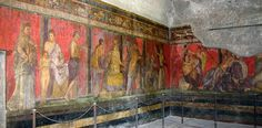 View of the Dionysiac frieze, Villa of the Mysteries, before 79 C.E., fresco, 15 x 22 feet, just outside the walls of Pompeii on the Road to Herculaneum. SECOND STYLE.