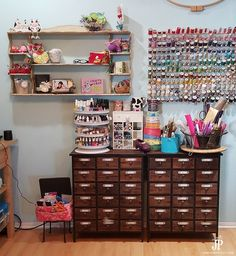 Love the cute displays in this craft room! The apothecary style cabinets from Hobby Lobby are great for small items and tools. Display cute projects and gifts on the shelves. Such a colorful craft room!