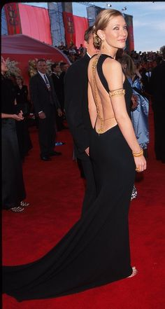 Cate Blanchett in backless black and gold armbands