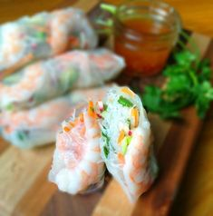 Fresh Rolls with Shrimp and Honey Lime Slaw - Light and refreshing, these fresh rolls are bursting with flavor from fresh herbs, lime juice and fish sauce. Addictive and delicious.