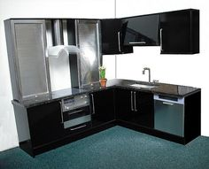 Playscale kitchen in black with steel    New playscale kitchen with opening cupboards and oven (fixed roller shutters). Underslung steel sink, and dummy built-in dishwasher.