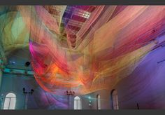 """Description The Smithsonian American Art Museum commissioned Janet Echelman to create an artwork to transform the Renwick Gallery's iconic Grand Salon. The WONDER Exhibition, the Renwick Gallery's first after an intensive 2-year renovation, """"transforms the entire museum into an immersive artwork."""" Echelman created a soft, voluminous net sculpture that surges through the air of the …"""