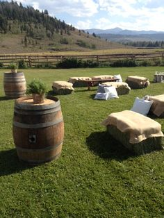 Picnic style wedding - wooden crates as tables. Bales of hay with scatter cushions for informal seating.
