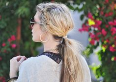 hair parted in the centre with a plait down the side of the head and low messy ponytail