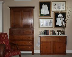 Shadow boxes of my daughters' baby dresses grouped alongside their photos in the particular dress that was framed.